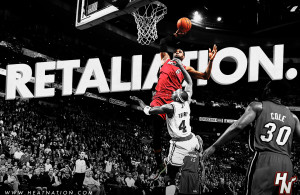 LeBron James of the Miami Heat throws down an unruly alley-oop dunk over Jason Terry of the Boston Celtics