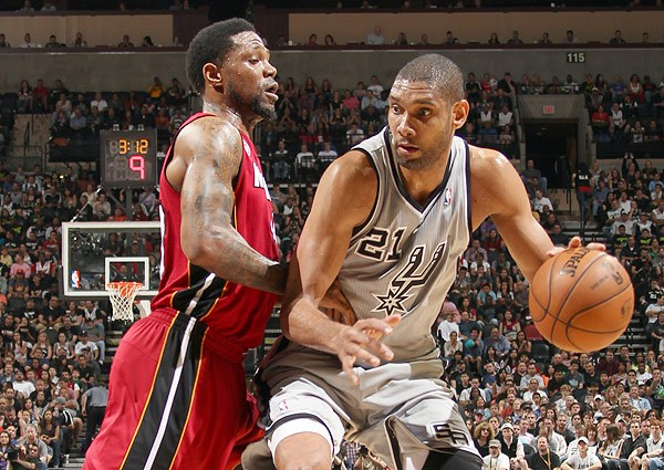 Udonis Haslem of the Heat plays defense on Tim Duncan of the San Antonio Spurs