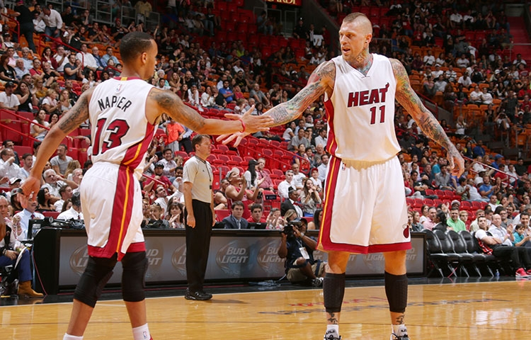 Shabazz Napier and Chris Andersen of the Miami Heat