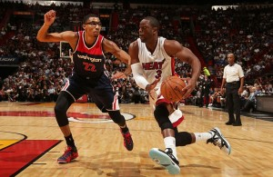 Dwyane Wade of Miami Heat against Otto Porter of Washington Wizards