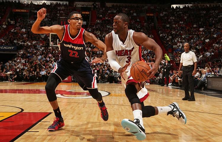 Dwyane Wade of Miami Heat against Otto Porter of Washington Wizards
