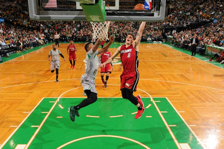 Tyler Johnson of the Miami Heat dunking