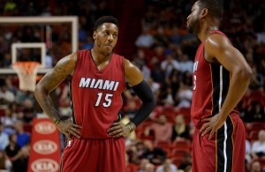 Dec 23, 2014; Miami, FL, USA; Miami Heat guard Mario Chalmers (left) talks with Miami Heat guard Dwyane Wade (right) during the first half against Philadelphia 76ers at American Airlines Arena. Mandatory Credit: Steve Mitchell-USA TODAY Sports