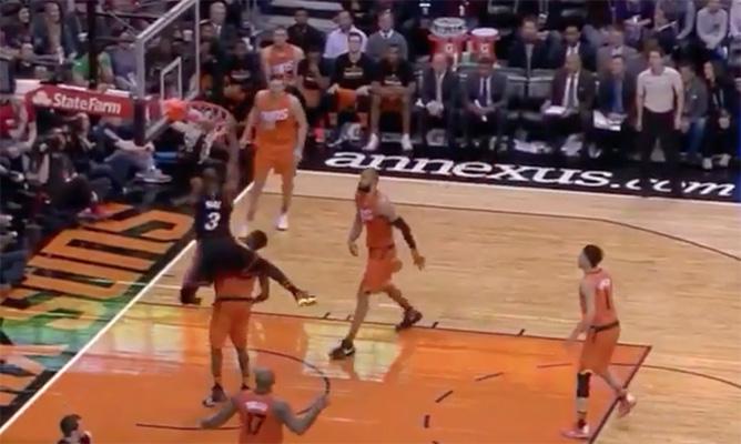 Dwyane Wade dunks on Brandon Knight