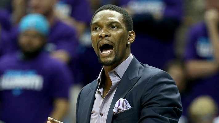 CHARLOTTE, NC - APRIL 25:  Chris Bosh #1 of the Miami Heat watches on from the bench against the Charlotte Hornets during game four of the Eastern Conference Quarterfinals of the 2016 NBA Playoffs at Time Warner Cable Arena on April 25, 2016 in Charlotte, North Carolina.  NOTE TO USER: User expressly acknowledges and agrees that, by downloading and or using this photograph, User is consenting to the terms and conditions of the Getty Images License Agreement.  (Photo by Streeter Lecka/Getty Images)