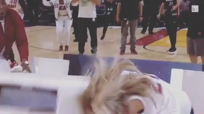 Video: Prop Door Falls on Heat Fan's Head During Halftime Promo