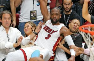 Dwyane Wade, Chrissy Teigen, and John Legend