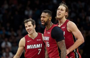 Goran Dragic, James Johnson, and Kelly Olynyk