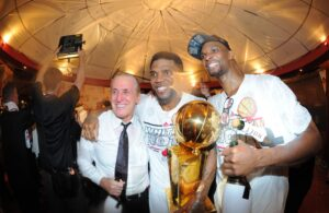 Pat Riley, Chris Bosh and Udonis Haslem